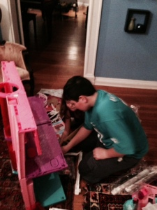 Brother-who-will-remain-nameless helps Larry set up the Barbie Dream House!