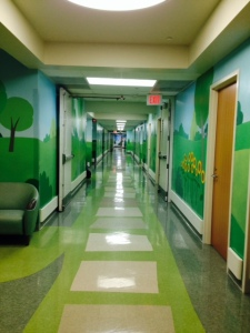 The walls are painted in beautiful murals representing the seasons of life, and of healing.
